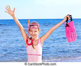 Child playing on  beach. - Little girl  playing on  beach.