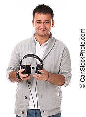 Young handsome man with headphones isolated over white...