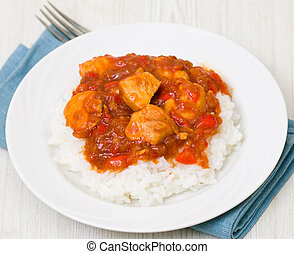 chicken breast with sauce and rice