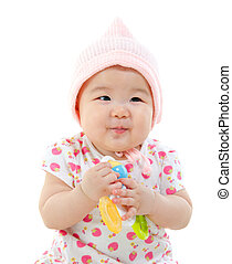 Asian baby girl gripping a toy - Asian baby girl in pink...