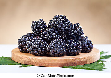 Blackberries on wooden plate - closeup