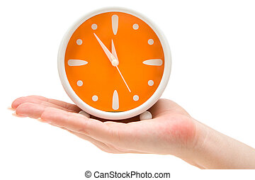 In Time - Woman holding an orange alarm clock Isolated on a...