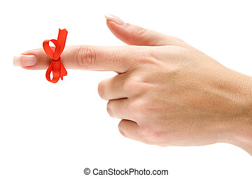 Guidance - Finger with red bow pointing left. Isolated on a...