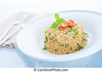 Chinese egg fried rice on dining table - Chinese egg fried...
