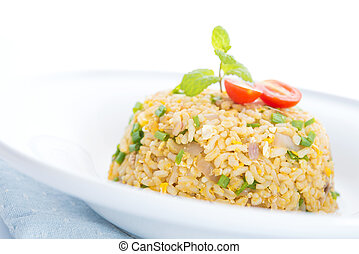 Chinese egg fried rice, Asian vegetarian cuisine ready to...