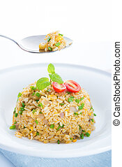 Delicious Chinese egg fried rice on dining table - Chinese...