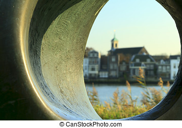 View of Dordrecht looking through a stone tube - Abstract...