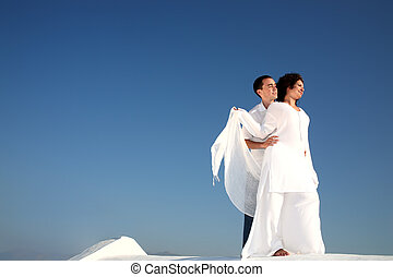 Young Happy Couple In White