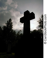 Stone cross portrait - A stone cross silhouetted against a...
