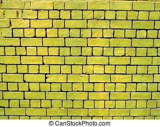 Yellow brick wall - A painted yellow brick wall with dark...