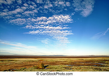 Blue sky and altocumulus clouds over Morecambe Bay - A view...