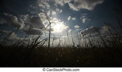 Wind turbine - Timelapse of wind turbine with grass in the...