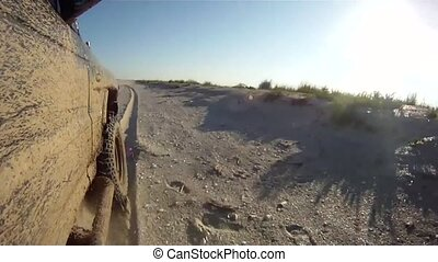 Off-road driving in sand on a beach