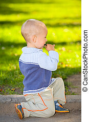 small boy - the small boy on a grass background