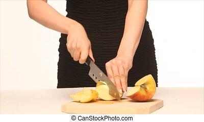 Beautiful girl chopping apple - Beautiful girl in simple...