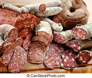 Assortment of different sliced salamis - Assortment of...