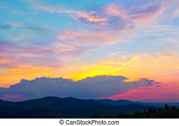 Colorful sky after sunset in the mountains