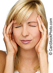 stress - young blond woman having a headache close up