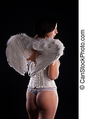 Back view of young woman in angel role