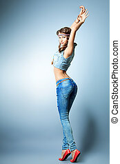 girl in jeans - Full length portrait of an attractive young...