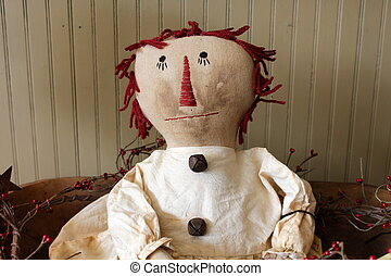 Old-fashioned doll in local shop - Old-fashioned stuffed...