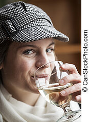 Young Woman Drinking White Wine - Portrait of a young woman...