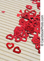 red hearts - a pile of red hearts on a corrugated cardboard...