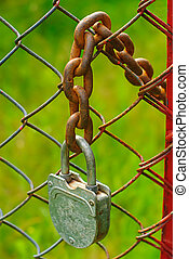 padlock and chain - old padlock and rusty  chain in farm