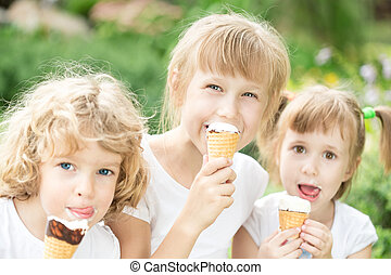 Children eating ice-cream - Happy children eating ice-cream...