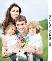 Happy family outdoors - Happy family having fun outdoors in...