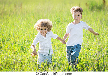 Children playing - Happy children playing in spring field