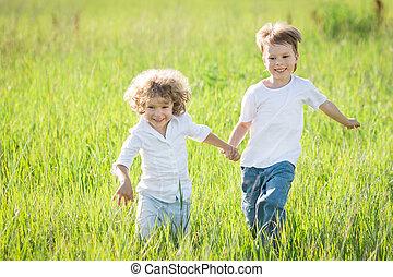 Children playing - Happy children playing in spring field