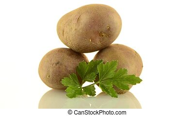 New potato tuber rotating on white background