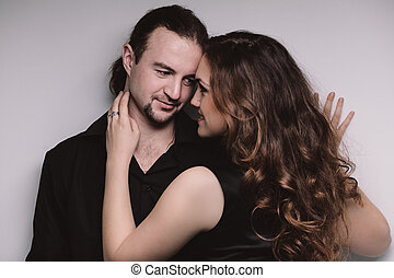 Flirting couple - Portrait of young flirting couple in...