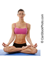 woman exercising yoga - active brunette in yoga position on...