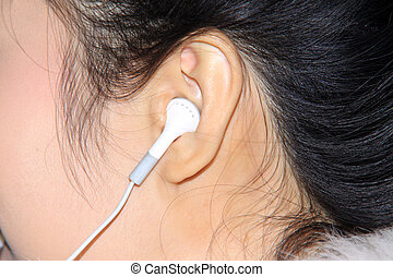 wearing headphones - a woman wearing headphones