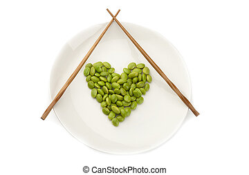 152 fresh soybeans - Fresh soybeans on a white plate with...