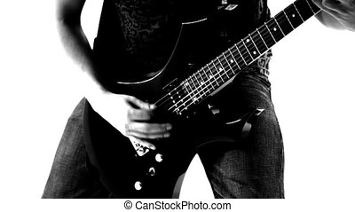Playing rock - Guitarist playing rock music Black and white...