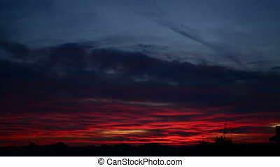 Red clouds during sunset - Red curtain of light reflected on...