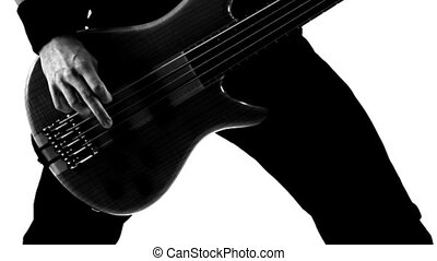 Playing guitar. Black and white.
