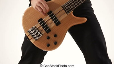 Playing electric guitar. Close-up