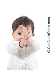 Baby with a karate gesture on a white isolated background...