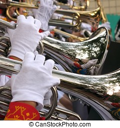 Female Trumpet Players - -- a high school band playing their...