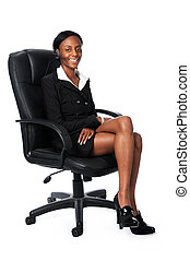 Business Woman Sitting on Chair - Young African American...