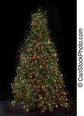 Image of a Christmas tree decorated with decorative Christmas electric lights against dark background.