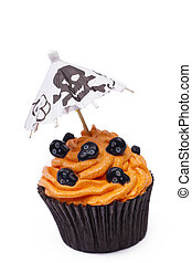image of a cupcake with skull topping over white background...
