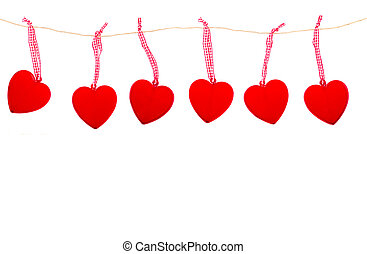 hanging hearts - red glass hearts hanging on rope isolated...