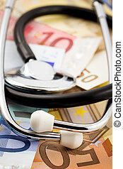Medical Expenses - Stethoscope on some money - medical...