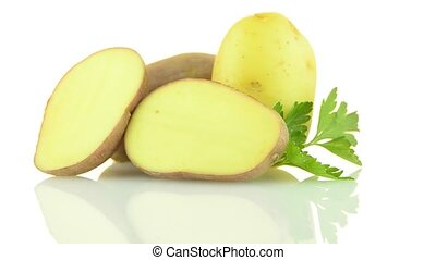 Red potatoes rotating on white reflective background