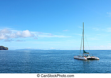 Adventure ship - White sailing ship - catamaran positioned...